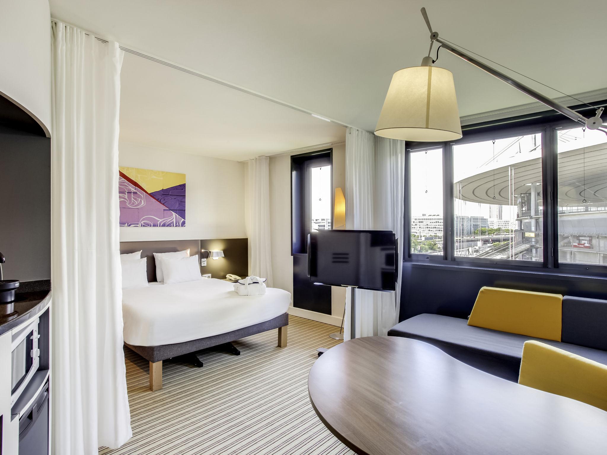 Отель — Отель Novotel Suites Париж Стад де Франс