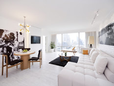 City view suite with classy white walls and wooden flooring with optional in-room bartender