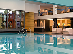 Stylish 'Fit and Spa Lounge' with large indoor swimming pool, saunas and relaxation area