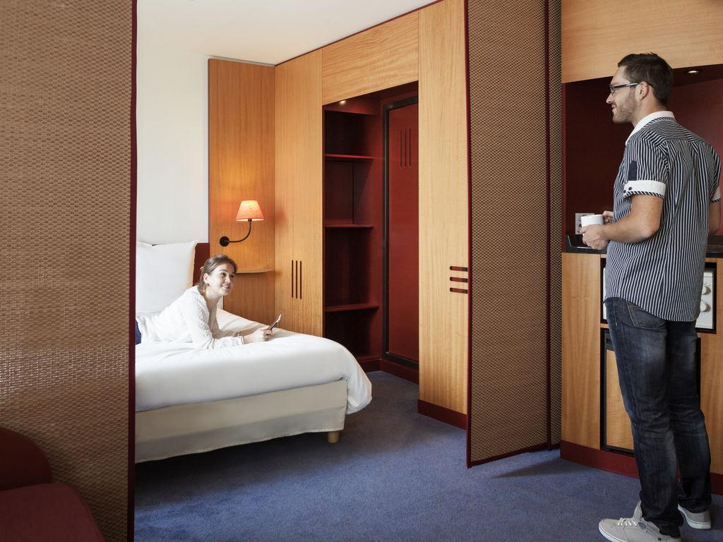 Suíte Superior com 1 cama de casal e duas camas de solteiro #9C6D2F 1024x768 Acessorios Banheiro Hotel