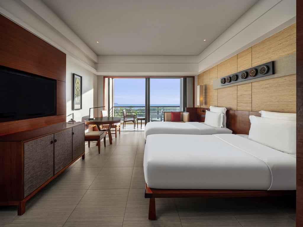 Hotel en sanya pullman oceanview sanya bay resort spa for Cama grand king