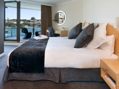 Enjoy Royal Botanic Garden or Sydney Harbour views from your balcony suite