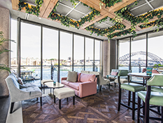 Meet at ECQ Bar for sunset drinks and Sydney Harbour views